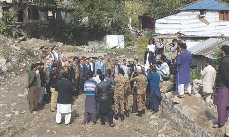 ARMY officers brief foreign diplomats on Tuesday during a visit to an area in the Neelum Valley that was hit badly by shelling from across the Line of Control.—AP