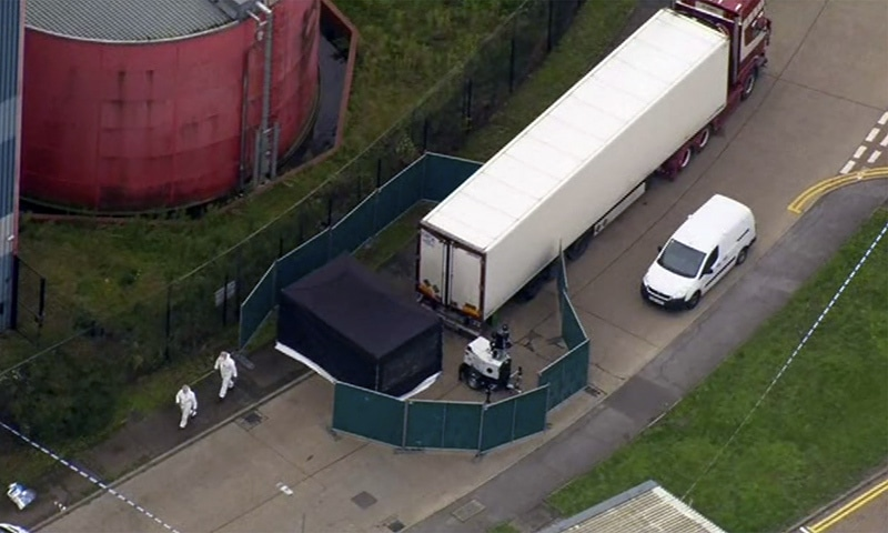 An aerial view as police forensic officers attend the scene after a truck was found to contain a large number of dead bodies, in Thurock, South England, Wednesday. — AP