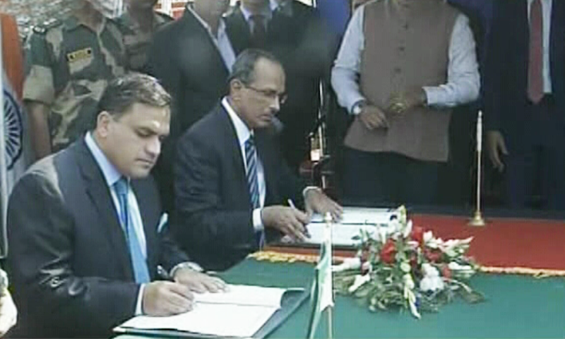 Dr Mohammad Faisal, director general (South Asia and Saarc) at the Foreign Office, and Indian Ministry of Home Affairs Joint Secretary S.C.L. Das signed the agreement at zero line, Pakistan - India Narowal border on Thursday, Oct 24. — DawnNewsTV