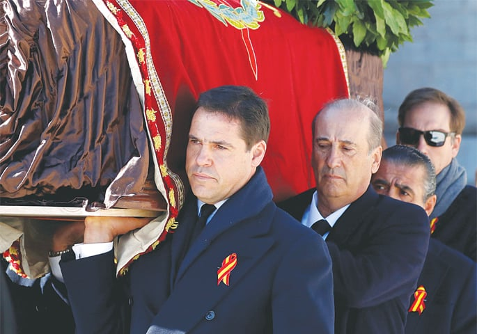 Spain reburies dictator Franco in discreet tomb