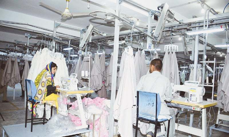Program means to improve working conditions in textile industry and make the sector more competitive. — AFP/File