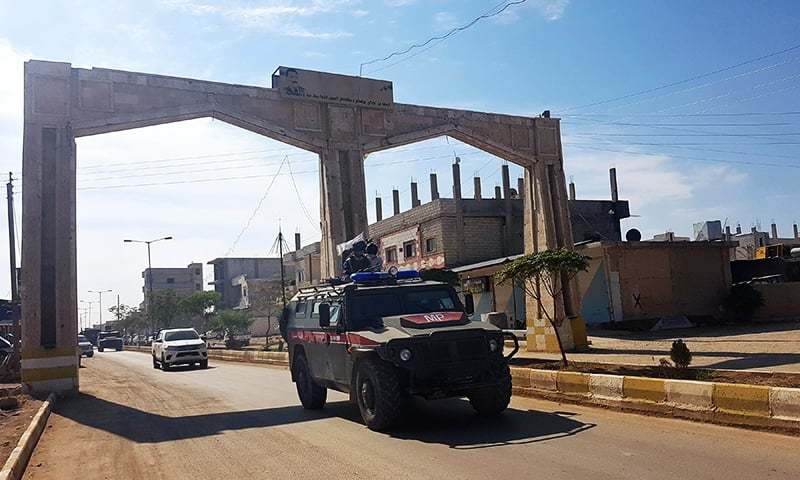 A handout picture obtained from the Syrian Kurdish North Press Agency on October 24, 2019 shows a Russian military police vehicle driving through the northeastern Syrian city of Kobane on October 23, 2019. — AFP/File