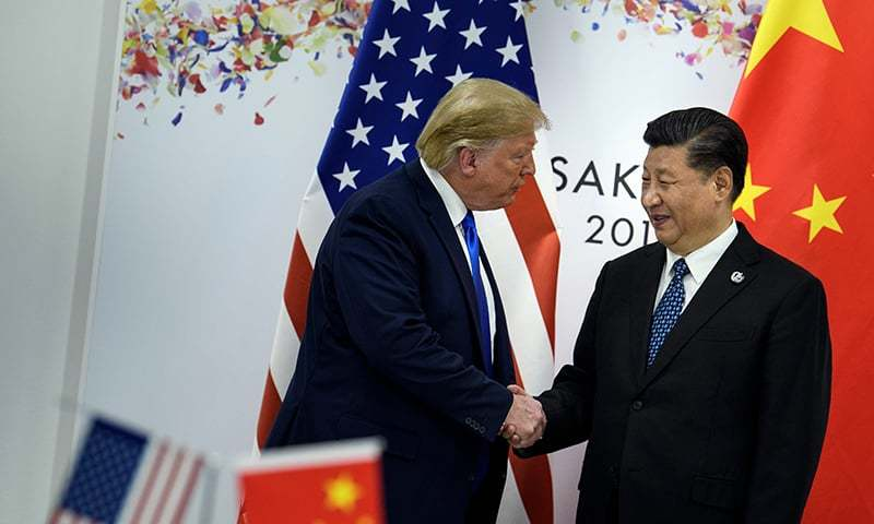 US President Donald Trump and Chinese President Xi Jinping shake hands at before a bilateral meeting on the sidelines of the G20 Summit in Osaka. — AFP/File