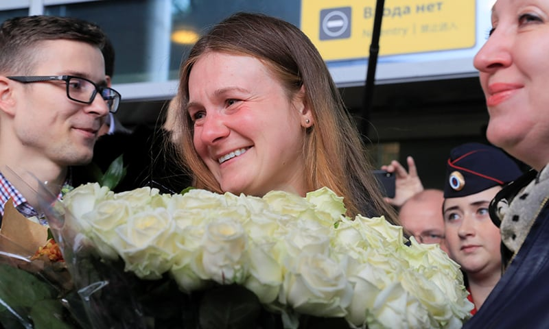 Convicted Russian agent Maria Butina, who was released from a Florida prison and then deported by US immigration officials, is welcomed by acquaintances and journalists upon the arrival at Sheremetyevo International Airport outside Moscow, on October 26, 2019. — Reuters