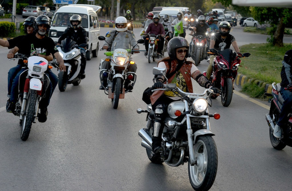 A woman motorcyclist rides at a heavy bikes safety rally organised by Islamabad traffic police | Mohammad Asim/White star