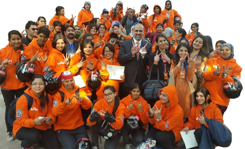 Former head Strategic Reforms Unit Salman Sufi with some participants of the Women on Wheels programme
