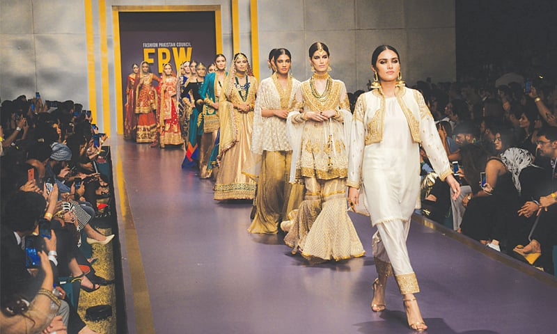 Designers Zainab Chottani and Nauman Arfeen (right) show their respective collections on day 3 of Fashion Pakistan Week Winter/Festive '19.—Shakil Adil/White Star