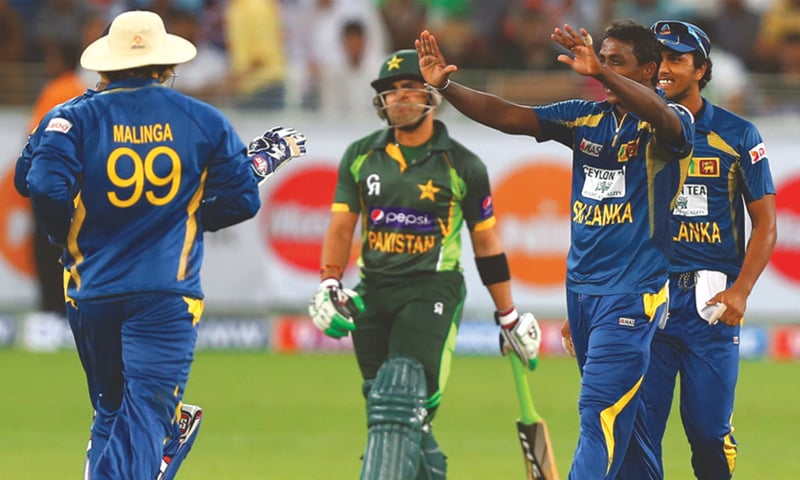 Sri Lanka's B team celebrating the fall of Umar Akmal's wicket during the second T20 in Lahore
