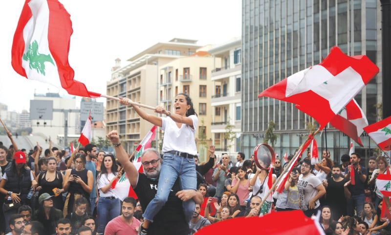 Lebanese take to streets for 10th day, defying Hezbollah