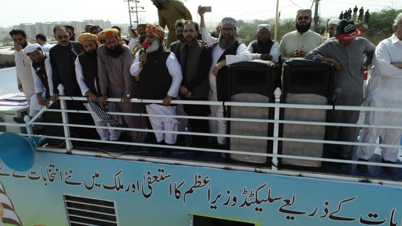 JUI-F chief Maulana Fazlur Rehman addressing the 'Solidarity with Kashmir' rally atop a container at Sohrab Goth. — JUI-P