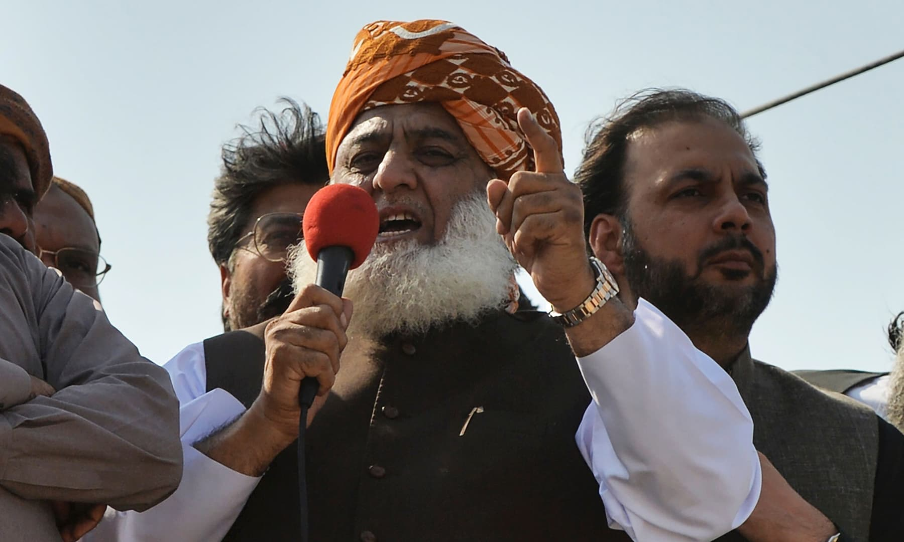 "Maulana Fazlur Rehman addresses supporters on his arrival to lead an anti-government ""Azadi March"" march towards Islamabad, in Karachi on Sunday. — AFP"