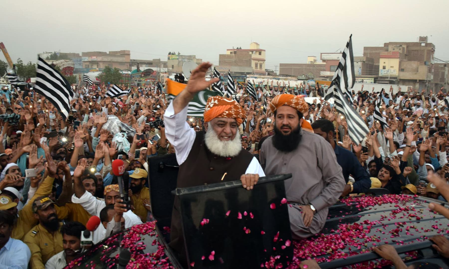 The JUI-F chief emerged from his vehicle to greet supporters in Hyderabad. — Photo courtesy Umair Ali