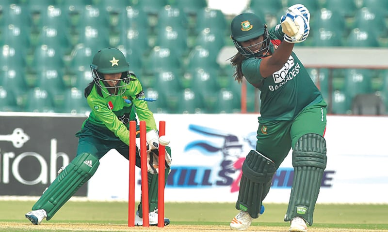 LAHORE: Bangladesh opener Ayasha Rahman is bowled by Pakistan spinner Anam Amin as wicket-keeper Sidra Nawaz looks on during the second T20 International at the Gaddafi Stadium on Monday.—M.Arif/White Star