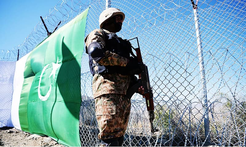 A Pakistani soldier keeps vigil next to a newly fenced border fencing along with Afghan's Paktika province border in Angoor Adda in Pakistan's South Waziristan tribal agency on October 18, 2017. — AFP