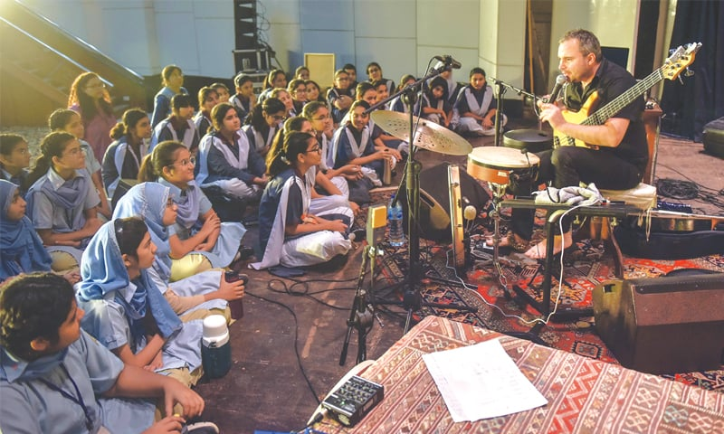KIDS interact with one of the musicians at Rangoonwala Hall on Wednesday.—White Star