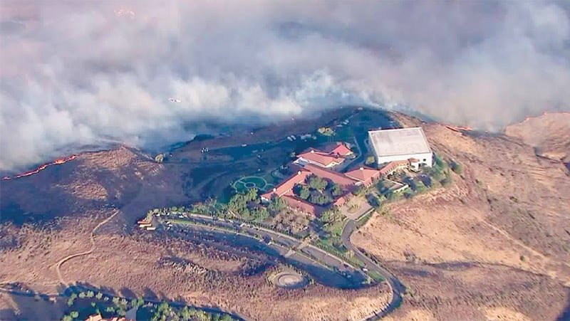 LOS ANGELES: This photo from video provided by a television channel shows the Ronald Reagan Presidential Library as flames approach California's Simi Valley.—AP