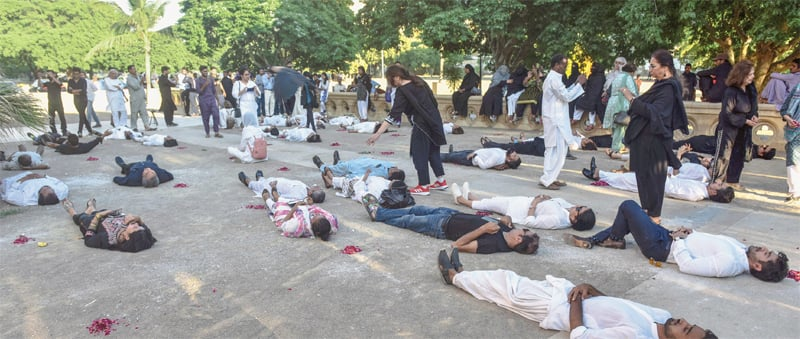 Activists lie on the floor in an act of protest at Frere Hall on Thursday.—White Star