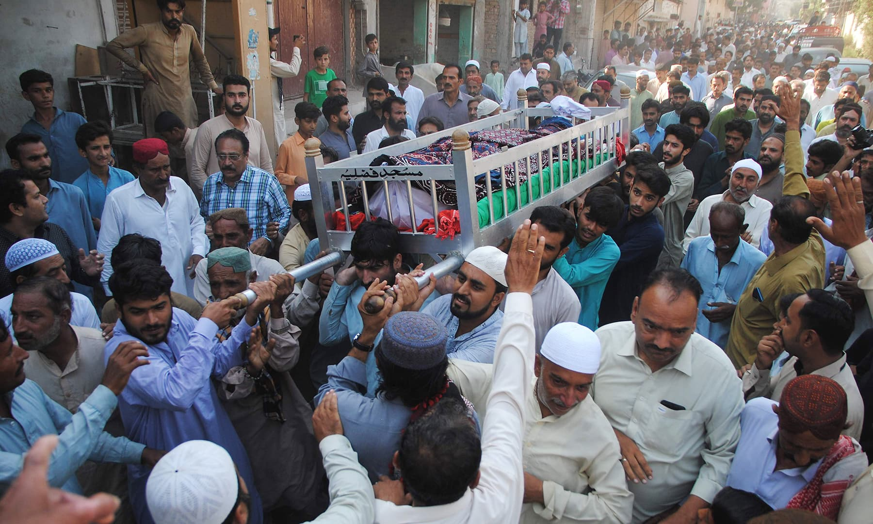 People attend the funeral of a train fire victim in Mirpurkhas on Friday, November 1. — AP