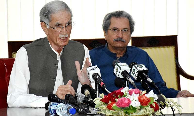 Defence Minister Pervez Khattak and Education Minister Shafqat Mahmood address a press conference. — PID/File