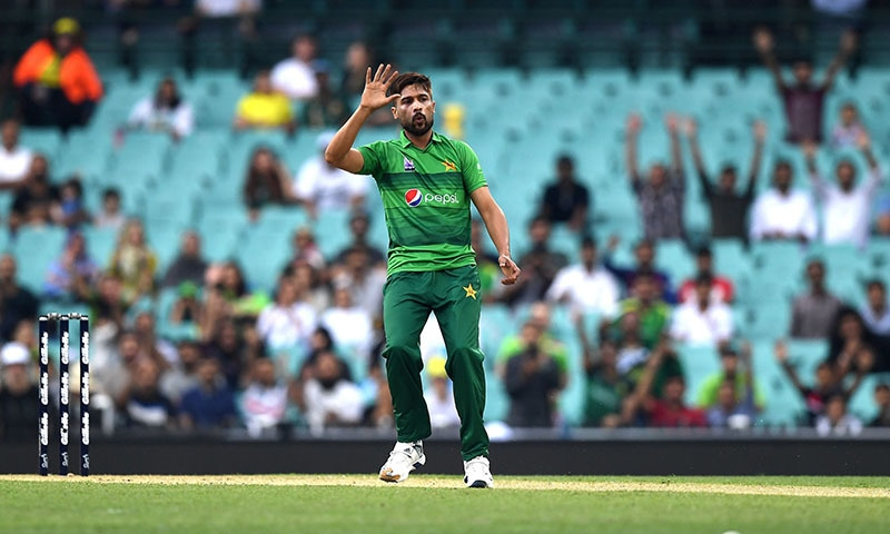Paceman Mohammad Amir reacts after he bowls bowls during the Twenty20 match between Australia and Pakistan at the Cricket Cricket Ground in Sydney on November 3. — AFP