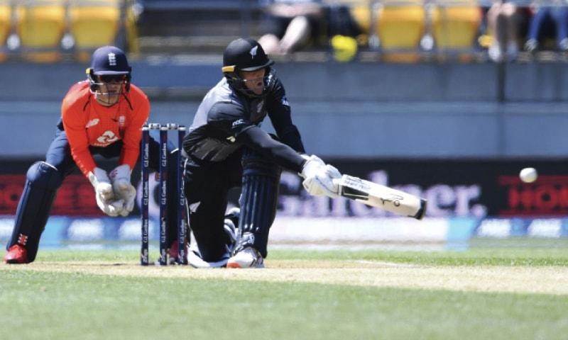 WELLINGTON: New Zealand opener Martin Guptill sweeps as England wicket-keeper Sam Billings looks on during the second Twenty20 International on Sunday.—AP