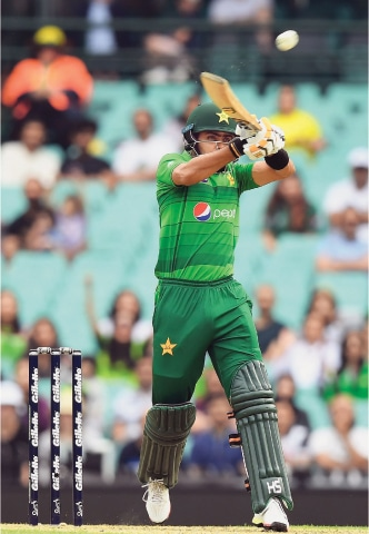 SYDNEY: Pakistan captain Babar Azam hits a six to complete his half century during the first Twenty20 International against Australia at the Sydney Cricket Ground on Sunday.—AFP
