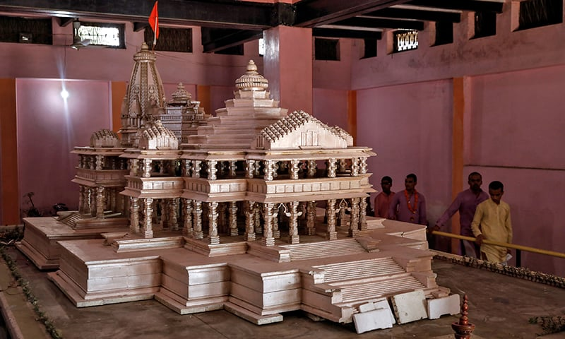 Devotees look at a model of the proposed Ram temple that Hindu groups want to build at a disputed religious site in Ayodhya, India. — Reuters