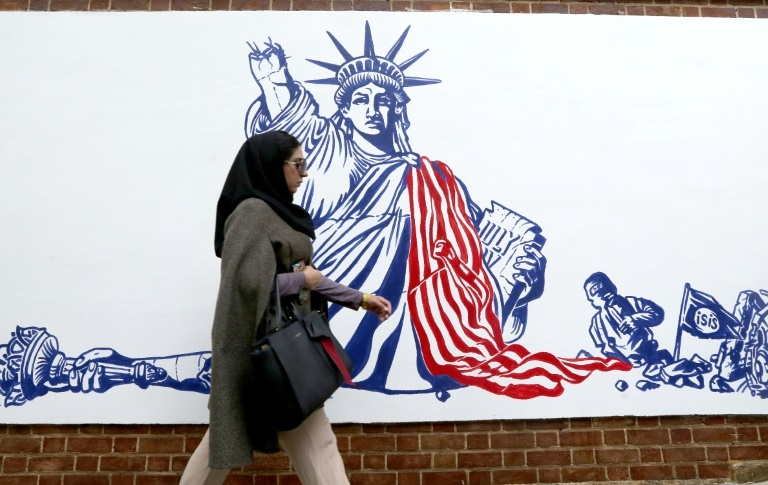 Iran unveiled new anti-American murals on the walls of the former embassy on Saturday with stark images of a crumbling Statue of Liberty, a downed US drone and skulls floating in a sea of blood. — AFP