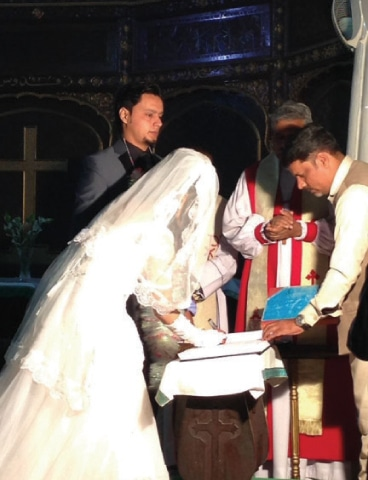 A couple being married in a church. The Christian Marriage and Divorce Bill aims to update 140-year-old Christian personal laws. — Photo by he writer