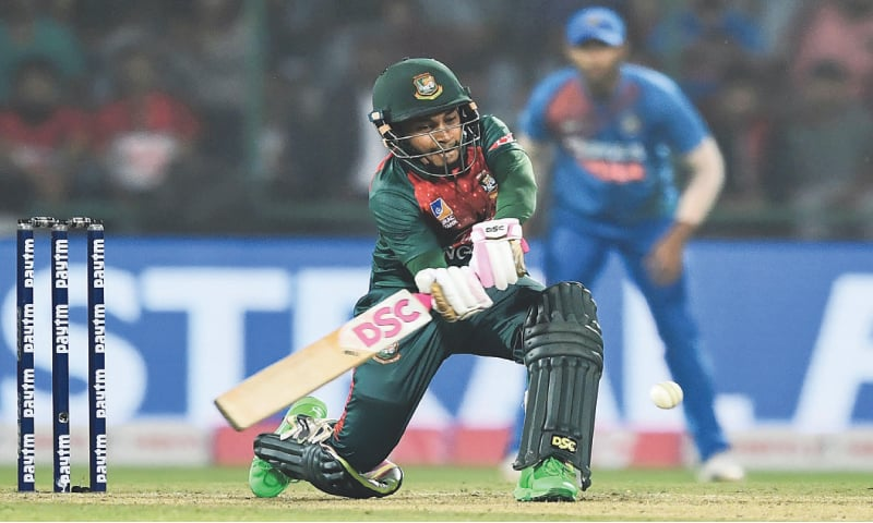 NEW DELHI: Bangladesh's Mushfiqur Rahim plays a shot during his unbeaen half-century in the first Twenty20 International against India at the Arun Jaitley Cricket Stadium.—AFP