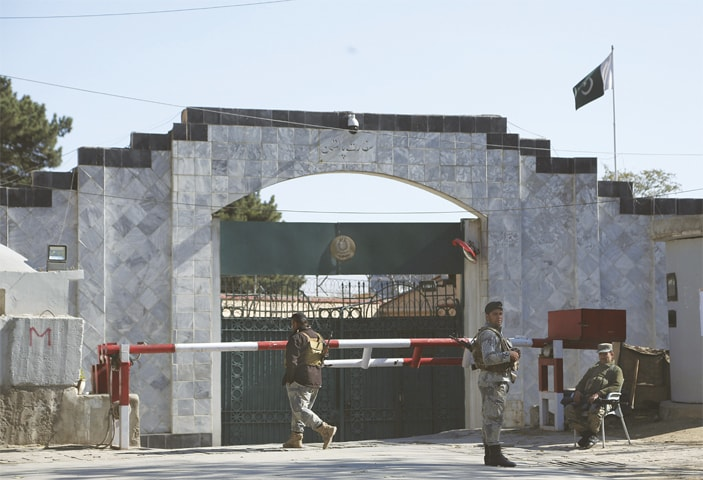 KABUL: Security personnel stand guard outside the Pakistan Embassy on Monday. The embassy announced indefinite closure of consular services, citing security concerns.—AP