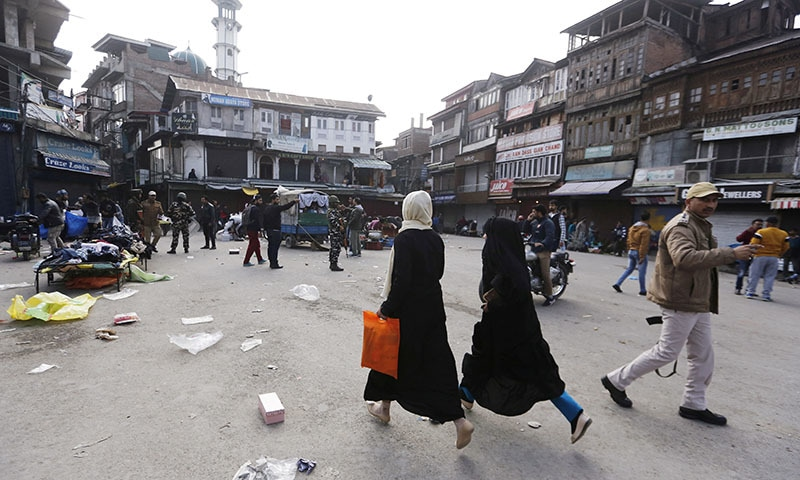 Kashmiri residents run at the site of a grenade blast in Srinagar on November 4. — Reuters