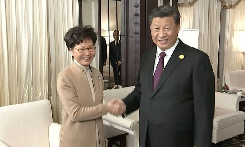 This video grab taken from footage released by China Central Television (CCTV) shows Chinese President Xi Jinping (R) and Hong Kong Chief Executive Carrie Lam shaking hands during their meeting in Shanghai on November 4, 2019. — AFP