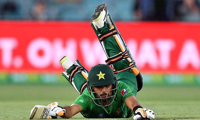 Babar Azam dives to avoid a possible run-out during the second Twenty20 match between Australia and Pakistan at the Manuka Oval in Canberra on November 5.  — AFP