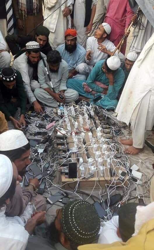 Azadi March participants charge their phones at the protest site. — Photo provided by Javed Hussain