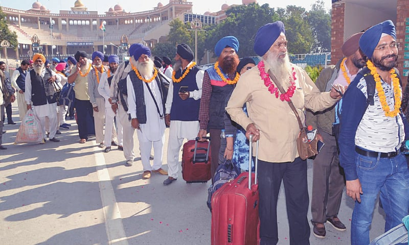 This handout picture shows Sikh pilgrims arriving at the Wagah border crossing on Tuesday to participate in the events marking the 550th birth anniversary of Baba Guru Nanak.