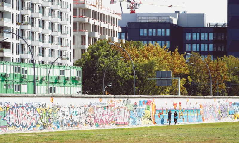 This Sept 19 file photo shows new apartment and office buildings  pictured beside the East Side Gallery, the largest remaining part of the former Berlin Wall.—Reuters