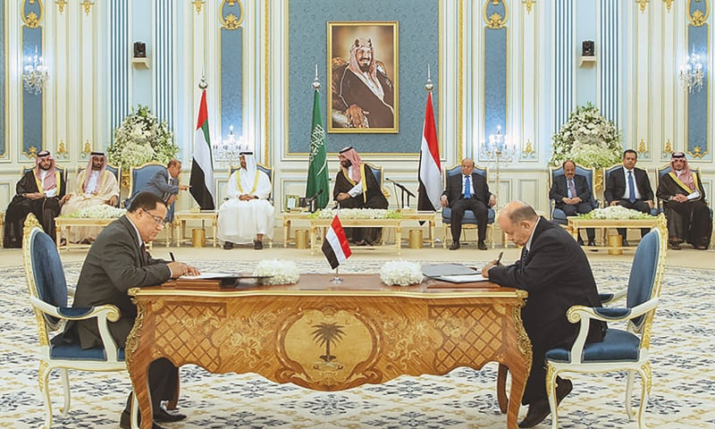 RIYADH: A handout picture shows (centre behind, left to right) Abu Dhabi Crown Prince Sheikh Mohamed bin Zayed al Nahyan, Saudi Crown Prince Mohammed bin Salman and Yemen's President Abd-Rabbu Mansour Hadi at the signing ceremony.—AFP