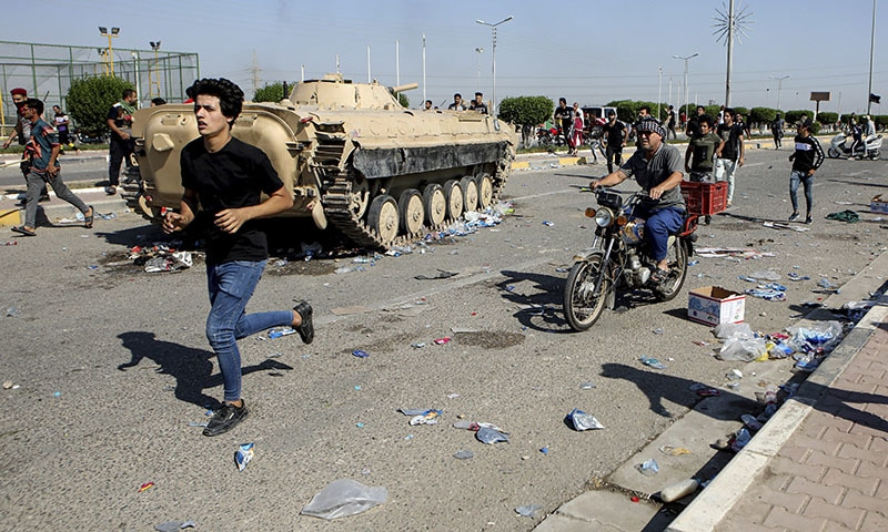 Anti-government protesters block the port of Umm Qasr while Iraqi security forces try to reopen the key oil terminal on the Persian Gulf, Iraq, Tuesday, Nov. 5. — AP