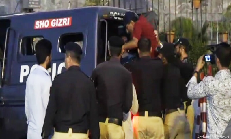 A college professor is dragged away by police after a protest against delays in time-scale promotions led to a massive traffic jam in Karachi on Wednesday. — DawnNewsTV