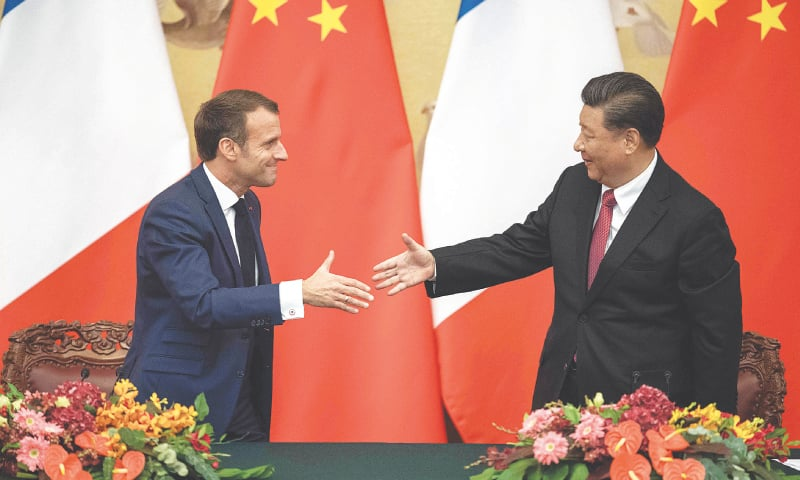 Beijing: French President Emmanuel Macron (left) shakes hands with his Chinese counterpart Xi Jinping following a signing ceremony at the Great Hall of the People on Wednesday.—AFP