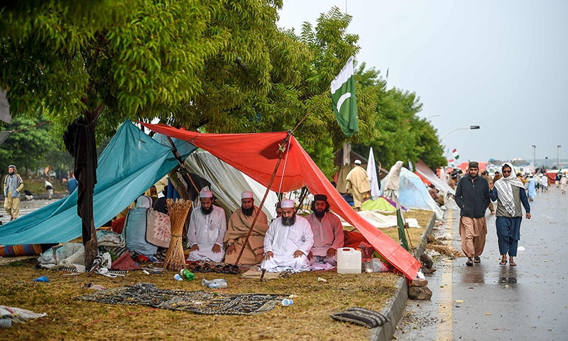 Azadi March participants undeterred by rain