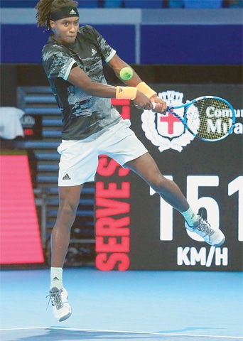 MILAN: Sweden's Mikael Ymer plays a return to Jannik Sinner of Italy during their match at the Next Gen ATP Finals.—AP