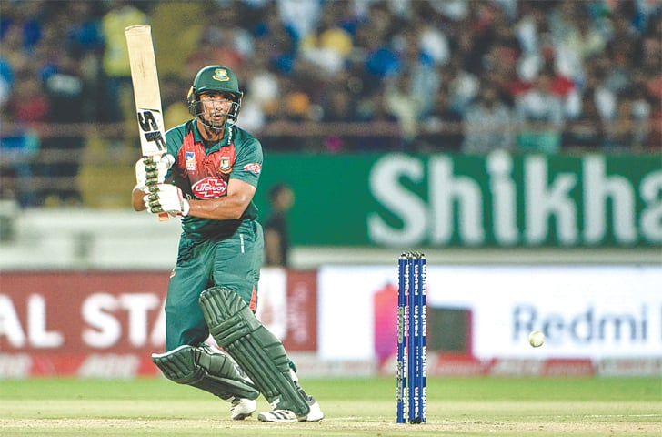 RAJKOT: Bangladesh captain Mahmudullah plays a shot during the second T20 International against India at the Saurashtra Cricket Association Stadium on Thursday.—AFP