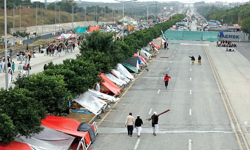 Scores of tents have been set up on Kashmir Highway near the Azadi March venue after rain lowered temperatures in Islamabad. — Photo by Mohammad Asim