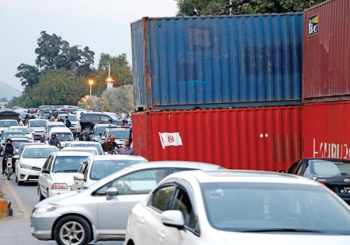 Traffic jam on main arteries a routine these days due to placement of containers. — White Star