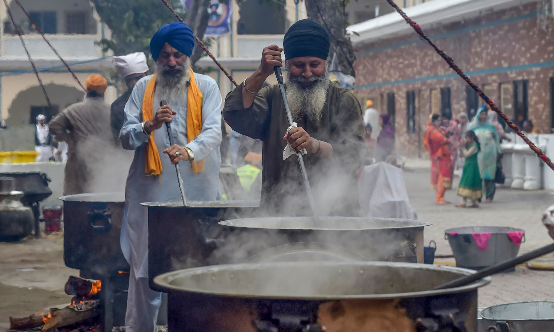Sikh pilgrims prepare food for devotees at a shrine in Nankana Sahib, some 75 km west of Lahore, on November 7. — AFP