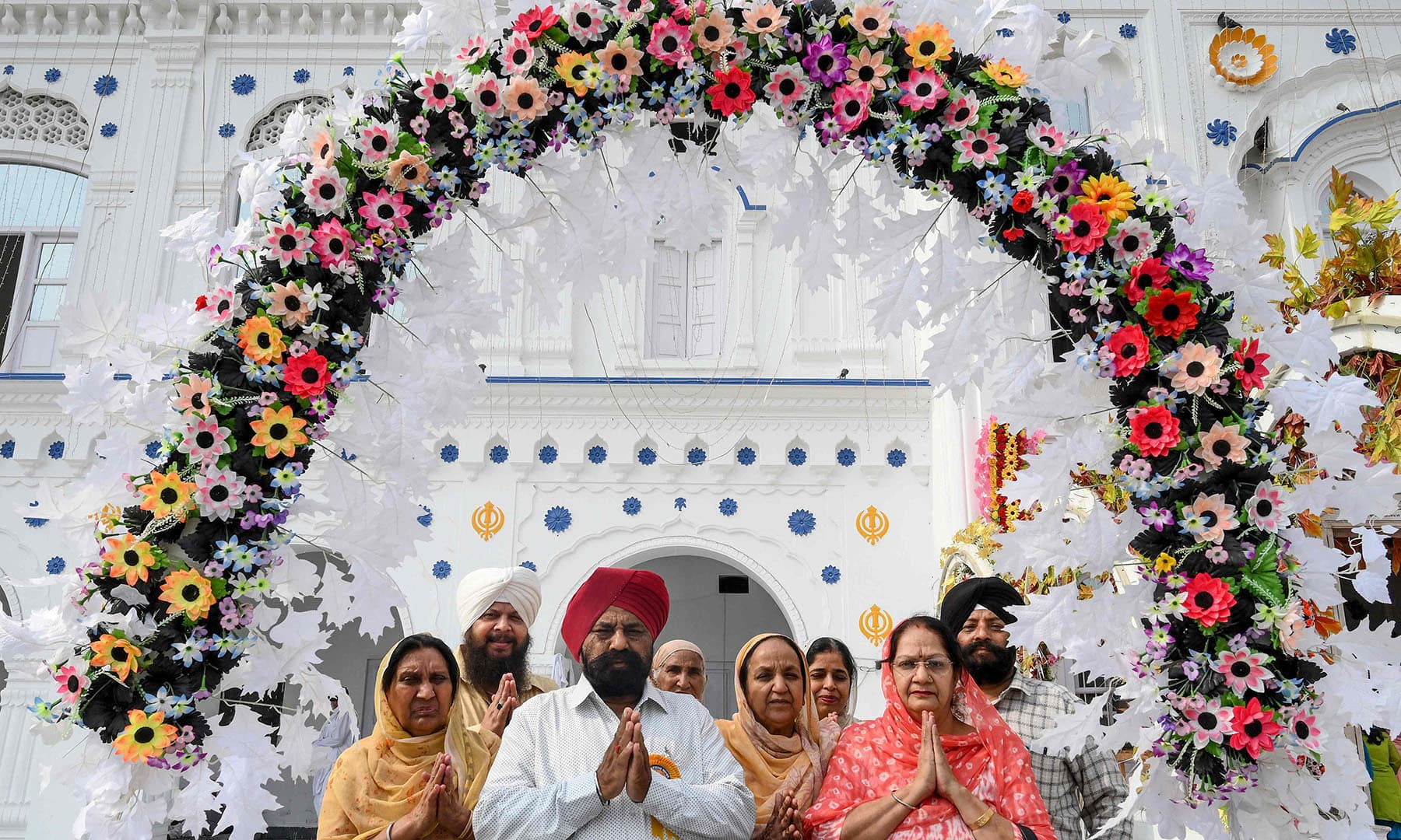 Sikh pilgrims pray as they take part in a ritual procession at a shrine in Nankana Sahib, some 75 km west of Lahore, on November 7. — AFP