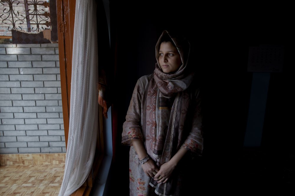 Newly married Kashmiri woman Kulsuma Rameez, 24, stands for photographs inside her home on the outskirts of Srinagar. Kulsuma says she was unable to shop for her wedding and borrowed her wedding dress from a relative. ─ AP