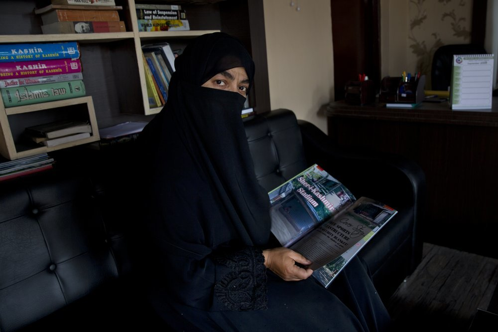 "Sahana Fatima, the first female entrepreneur in printing who runs the only sports magazine in the Kashmir valley, sits for a photograph inside her office in Srinagar. Fatima says they were unable to print the August edition due to the blockade. ""Even if we had decided to print, what would we write about? There was nothing happening as far as sports activities were concerned. Everything has come to a standstill."" ─ AP"